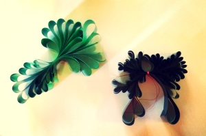 Reuse old video tape reel or ribbon, fold and staple to make beautiful garlands and hanging decorations.