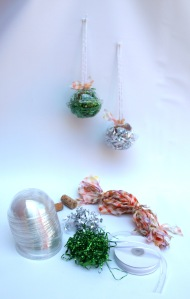 Christmas baubles made from old takeaway juice tops - fill with your favourite tinsel and attach with ribbon/material anchored to a cork!