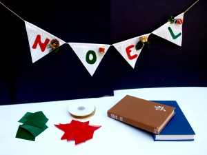 Christmas bunting made from twine, red & green card/vinyl offcuts and flags made from old tired books.